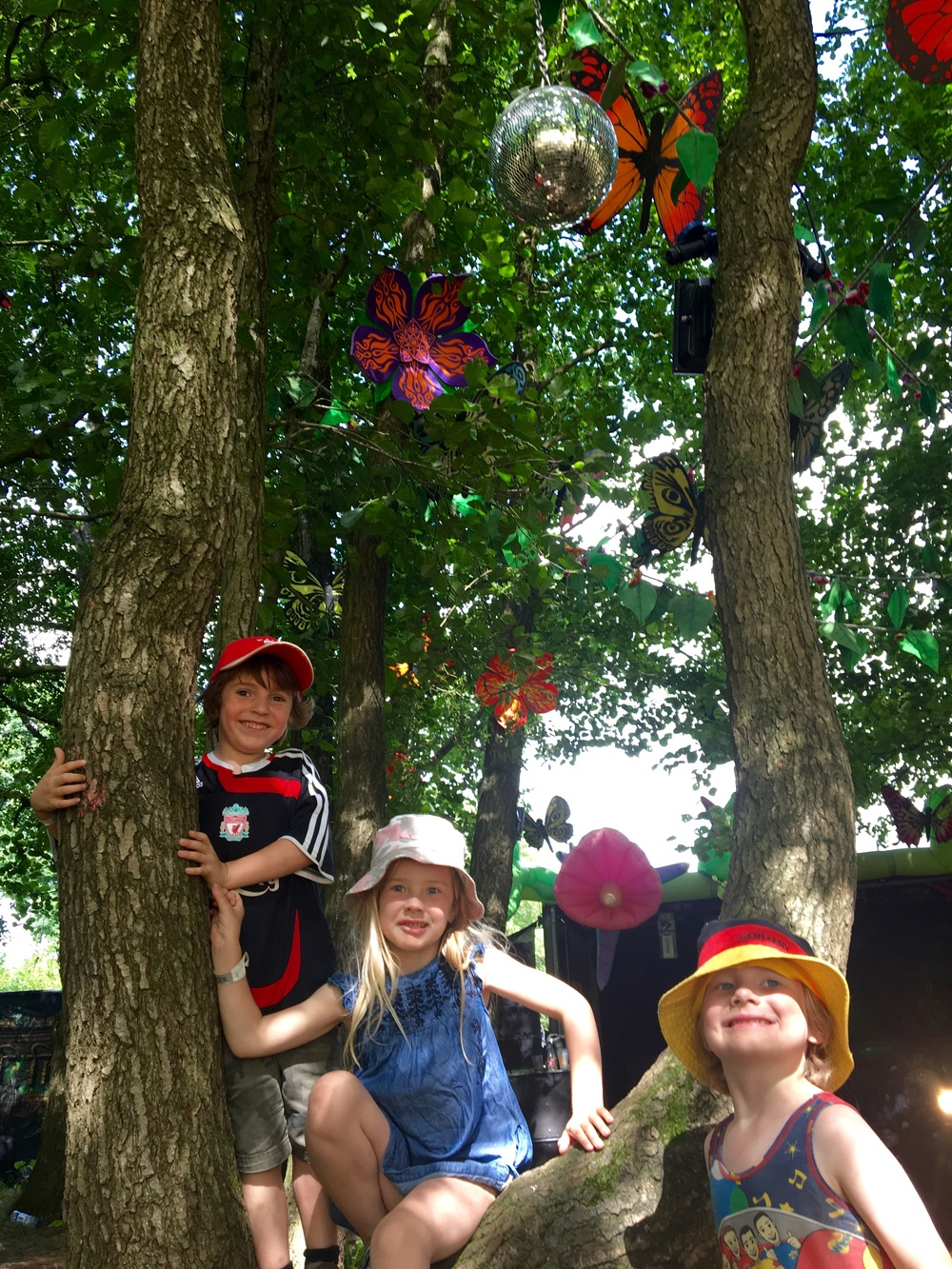 The kids in the Trance woods, climbing trees amongst UV butterflies. What's not to love?