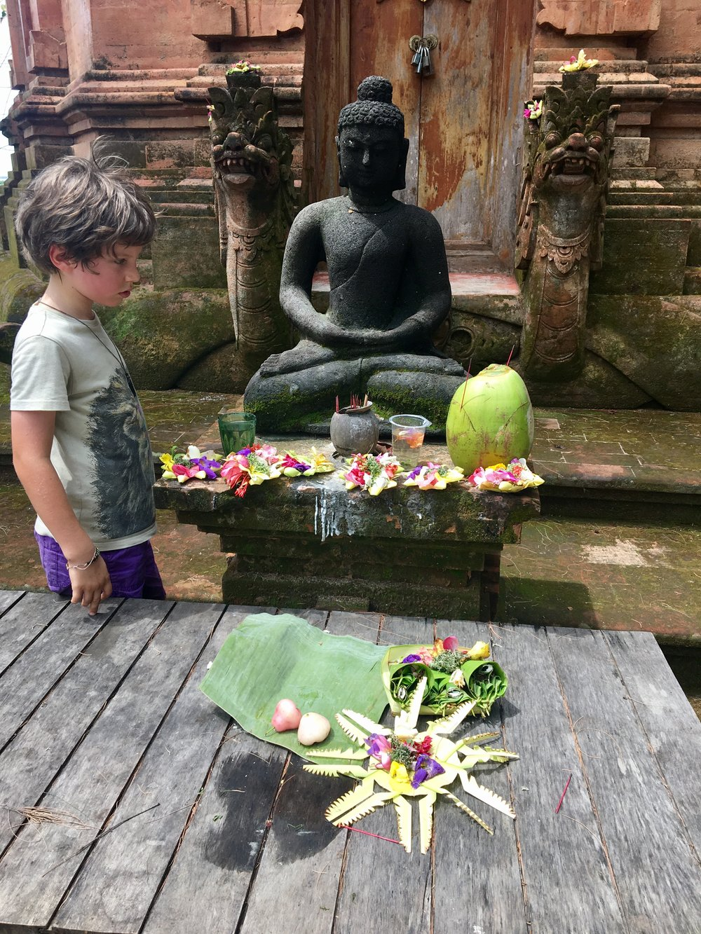 Offerings at the Buddhist Temple. An elder followed us around as apparently he needed to check that, as foreigners, we did not wee on the monument.