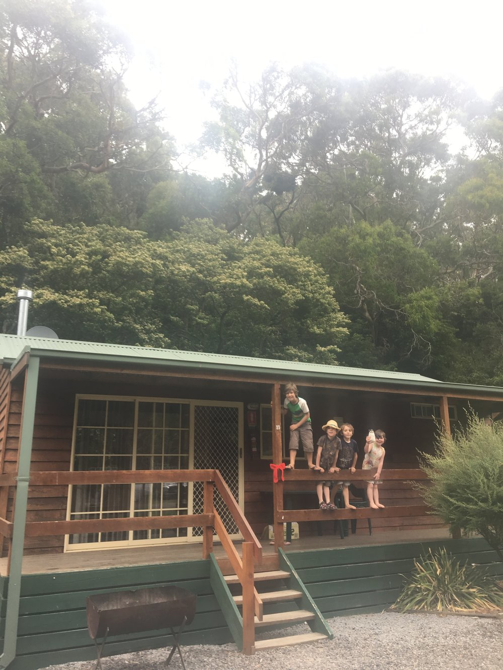 The kids outside our lovely cabin in Lorne. Note the crocheted festive bow on the porch? I did that.