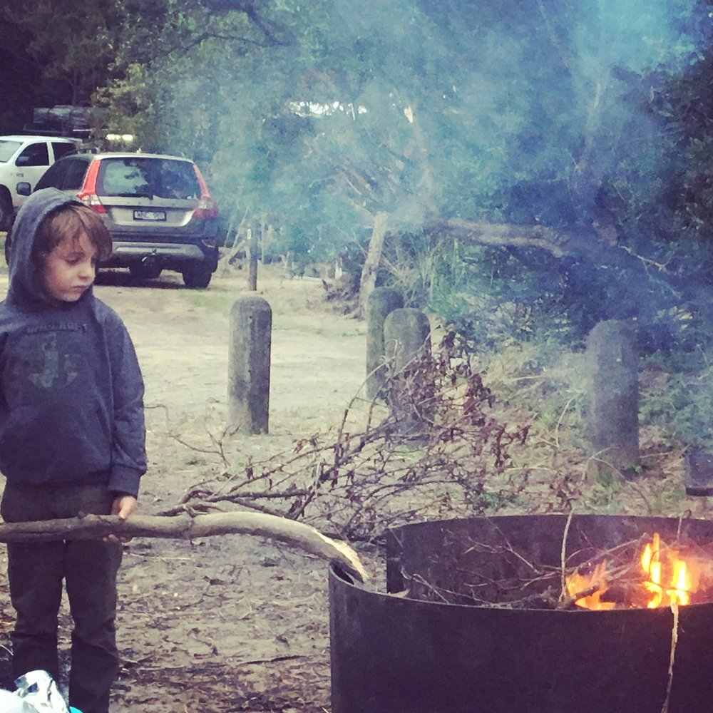 The Youngest waiting to make S'mores, courtesy of James and Chris.