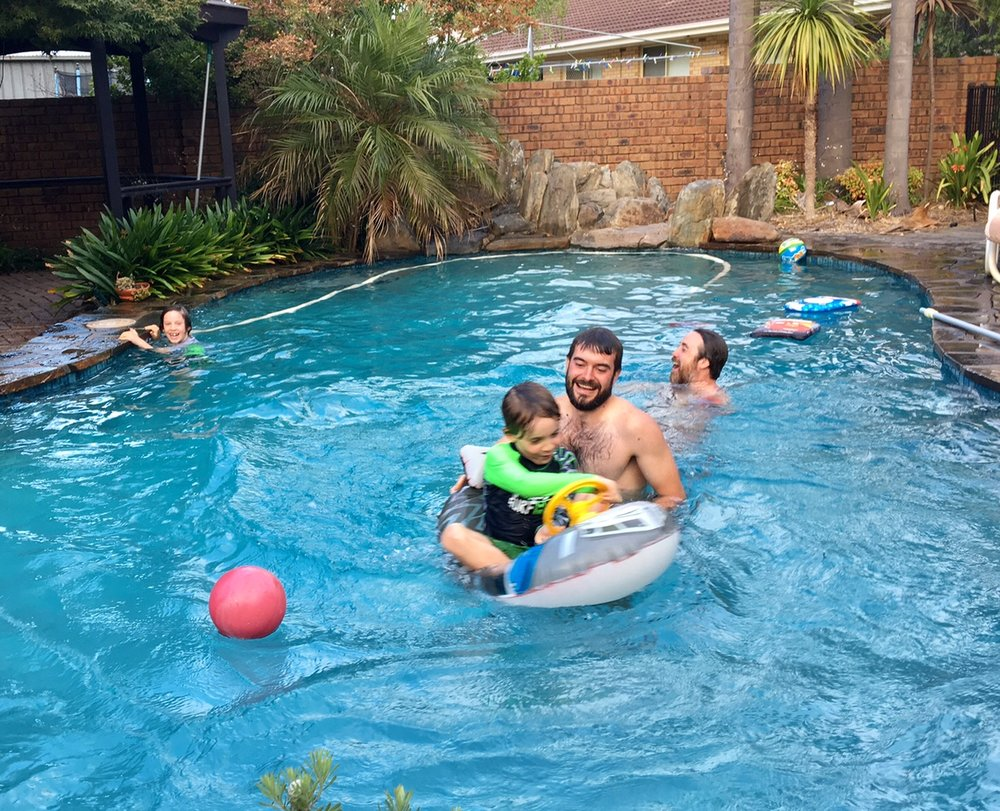 Chris and James splashing about with the boys.