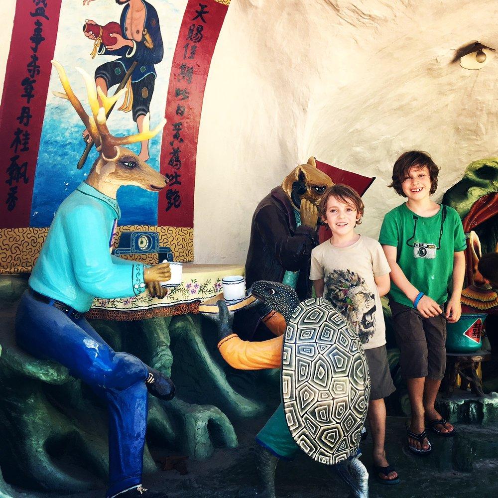 The boys amongst the strange fibreglass tea party.