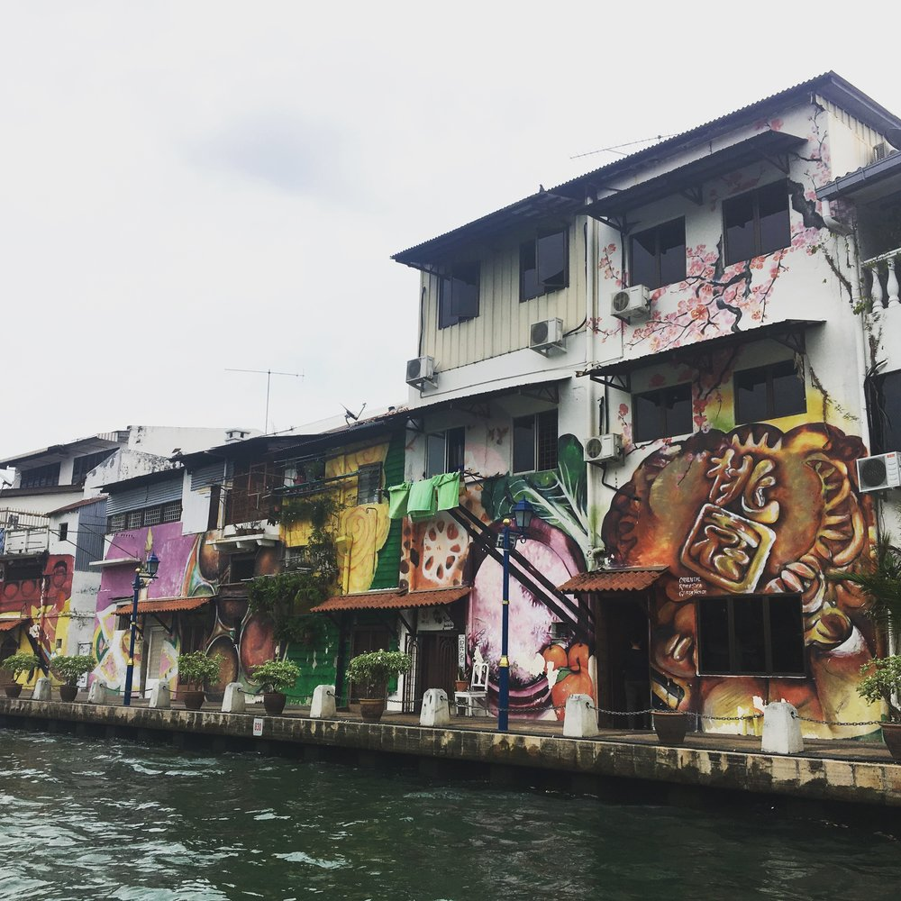 We did the Malacca River cruise to see art along the Malacca river and the living museum of traditional Malay houses. It was fun AND we got free chocolate biscuits.
