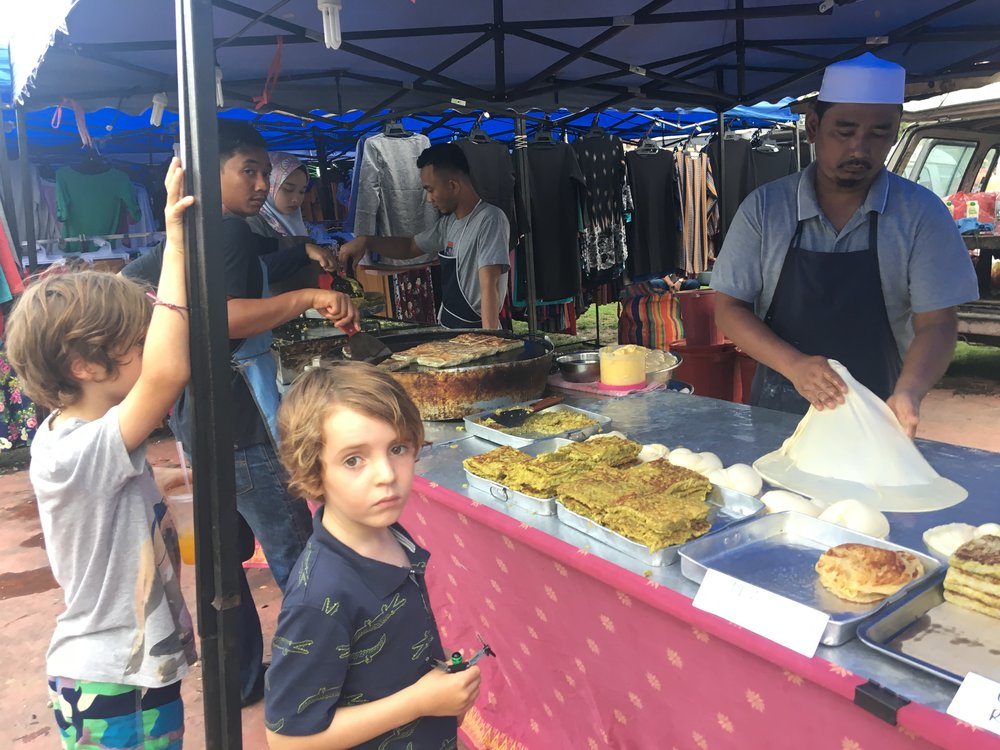 The boys mesmerised by the man making Murtabak. Became their favourite food and was cheap and fresh at the Night market.