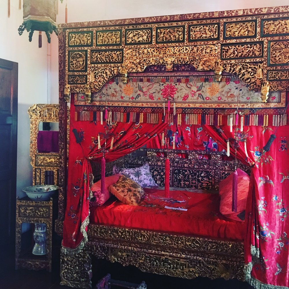 A bed in the Penang Peranakan Mansion. beautiful, lavish opulence we could only imagine living in such a place.