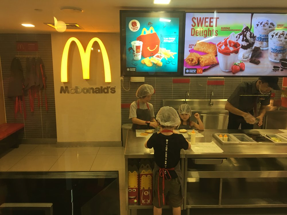 The boys playing at working in McDonald's and making their own lunch.