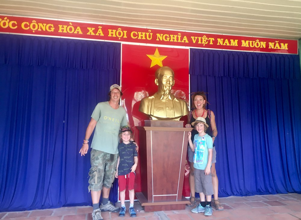 Us with a bust of 'Uncle Ho'.