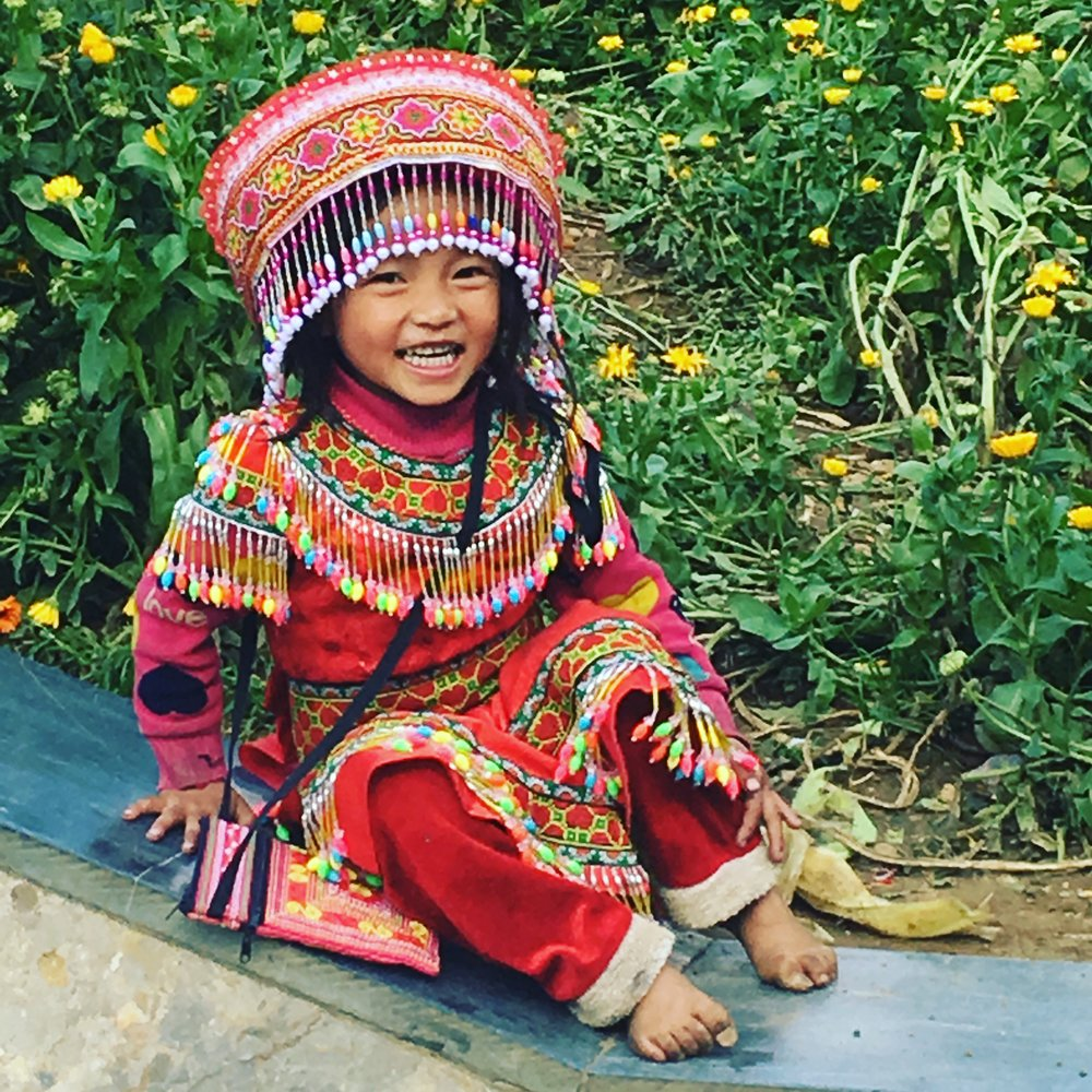 Flower Hmong girl in the town square.