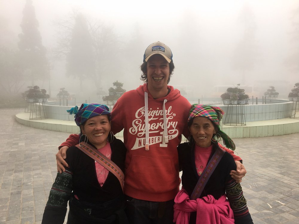 Hanging out with the lovely tribe ladies in the town square. They peddle their wares but also love a chat! Here's Mike, a cloud sweeping in behind them.