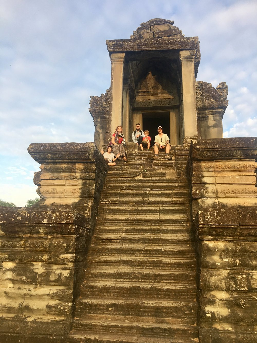 Up the steep steps at Angkor Wat.