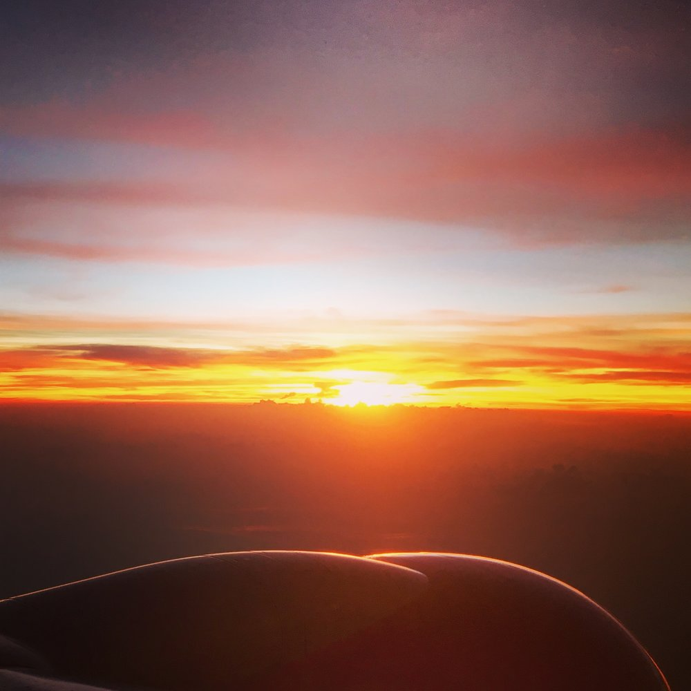 View from the plane as the sun was setting on our way to Nepal.