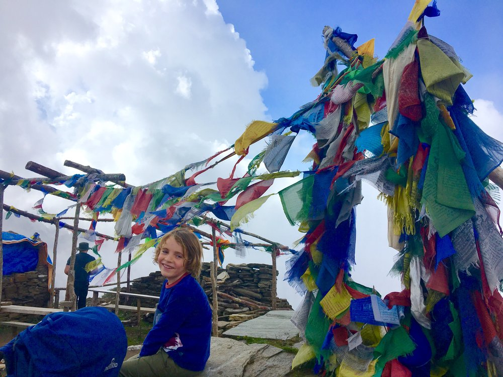 the Youngest, taking a break amongst the prayer flags.