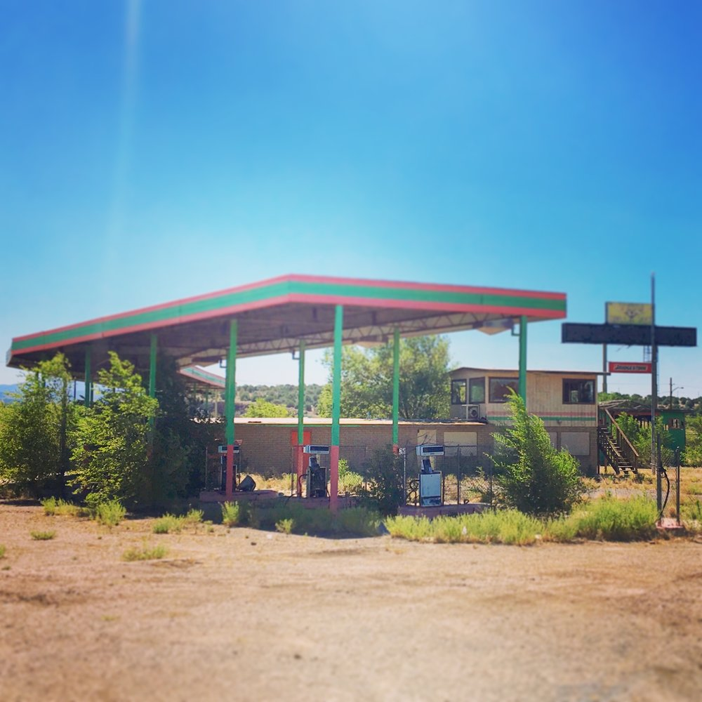 Derelict fuel station on Route 66. There were lots of businesses and homes that have fallen into disrepair... people living in trailers in the desert whilst houses were empty. Lots of ghost towns and fallen grandeur.