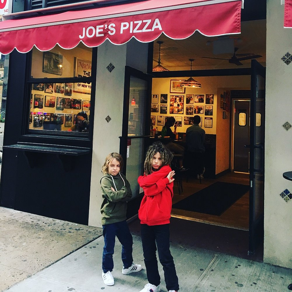 Outside Joes pizza which is covered with photos of all the celebrities that eat there. Peter Parker even WORKED here. Great pizza too.