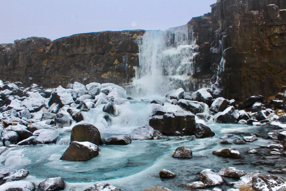 Partially frozen waterfall at Thingvellir National Park.  ICE BLUE is a real colour.