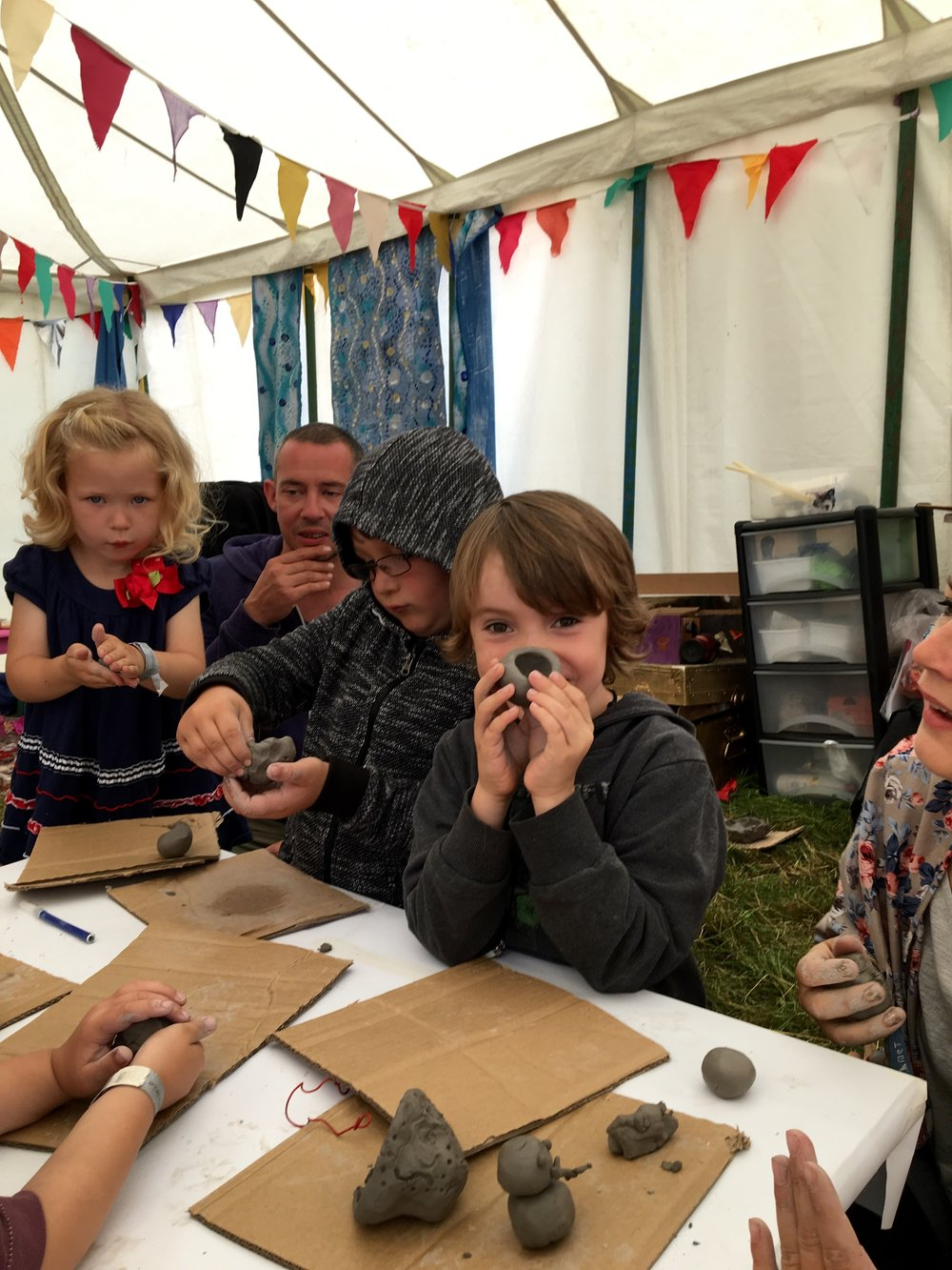 Making clay pots in the craft tent. (Not sure they made it home though... ssh)