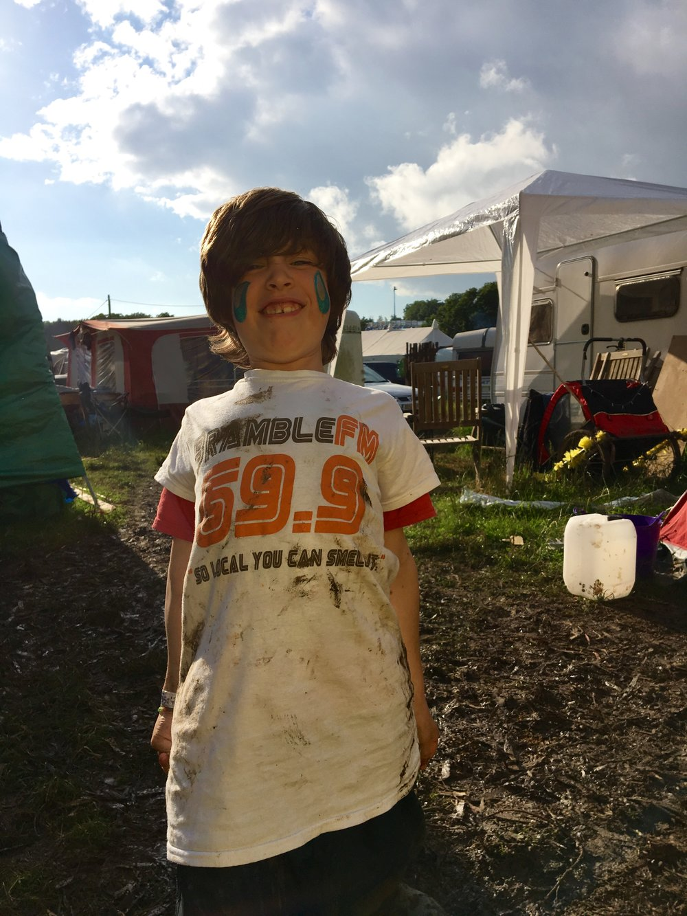A muddy Glastonbury; a happy boy.