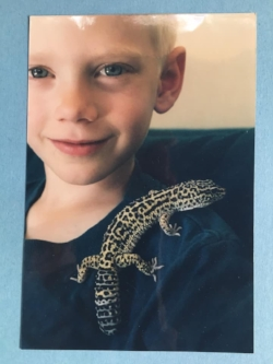 Monica writes: Twenty years ago, we were moving from Finland. Mika was sad to leave his leopard geckos behind. His only consolation was that he could get two pet rats (Bert & Ernie) once we were in the States. This is my favorite photo of him. His eyes were so trusting of us.