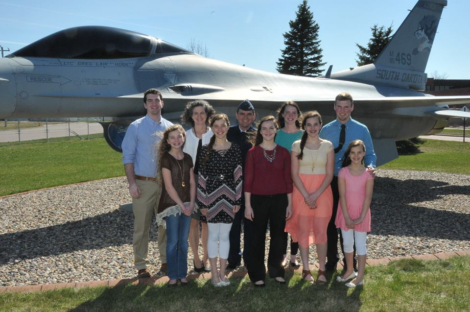 Harrison Lippert with wife Pam, and children, Nathan, Jani, Kyle, Jessica, Bethany, Natalie, Chaylie, & Karis