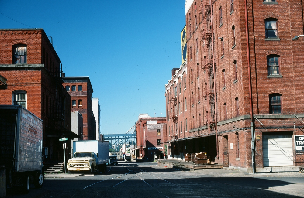 By the 1980s, the developers had discovered its potential.  An existing collection of empty or underutilized warehouses was turned into commercial and residential loft spaces.  An existing viaduct—the Lovejoy Ramp—was a physical barrier to efficient redevelopment.  Its days were numbered.