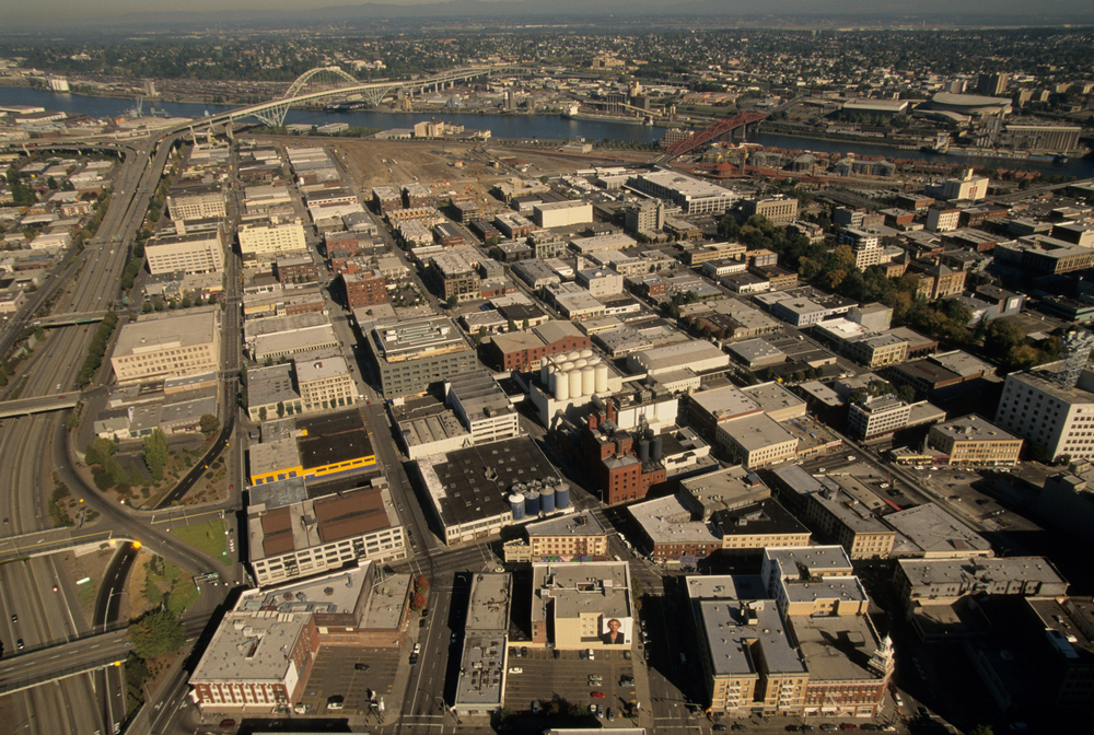 Adaptive reuse of old warehouses continued, but a checkerboard of new city blocks began to sprout mid and high-rise structures.  The Northwest Triangle was becoming the Pearl District. Photo by Bruce Forster©