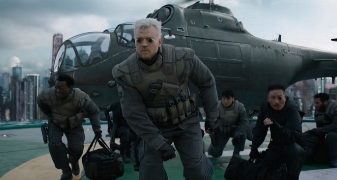 In between shooting people in the face, Batou really likes feeding his dogs.