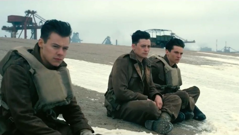 Harry Styles, Aneurin Barnard, and Fionn Whitehead star in 'Dunkirk'.