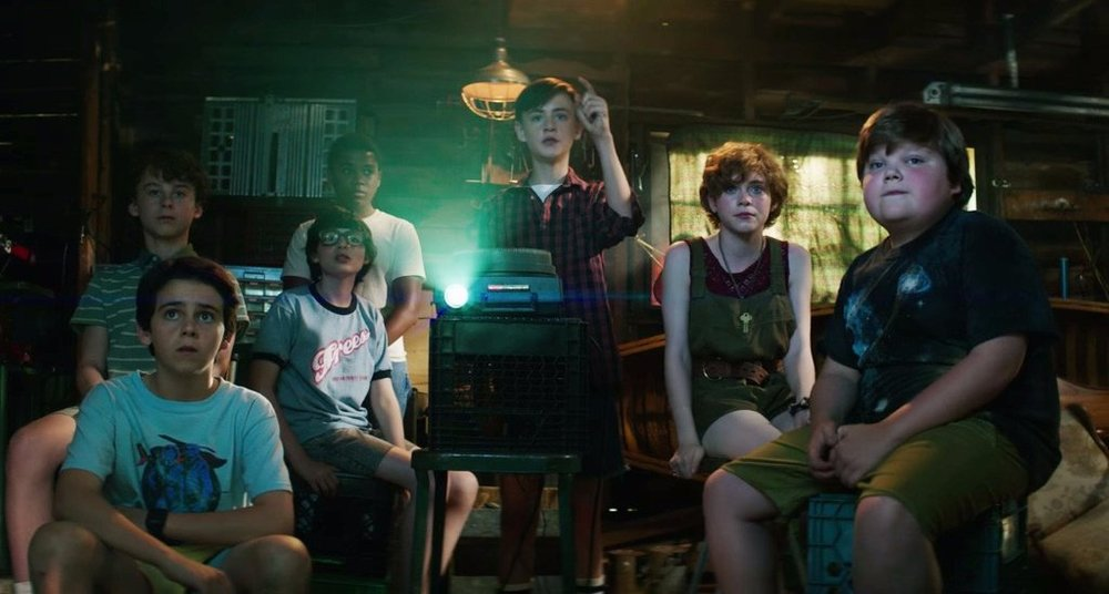 Clockwise from left foreground: Jack Dylan Grazer, Wyatt Oleff, Finn Wolfhard, Chosen Jacobs, Jaeden Lieberher, Sophia Lillis, and Jeremy Ray Taylor star in 'It'.