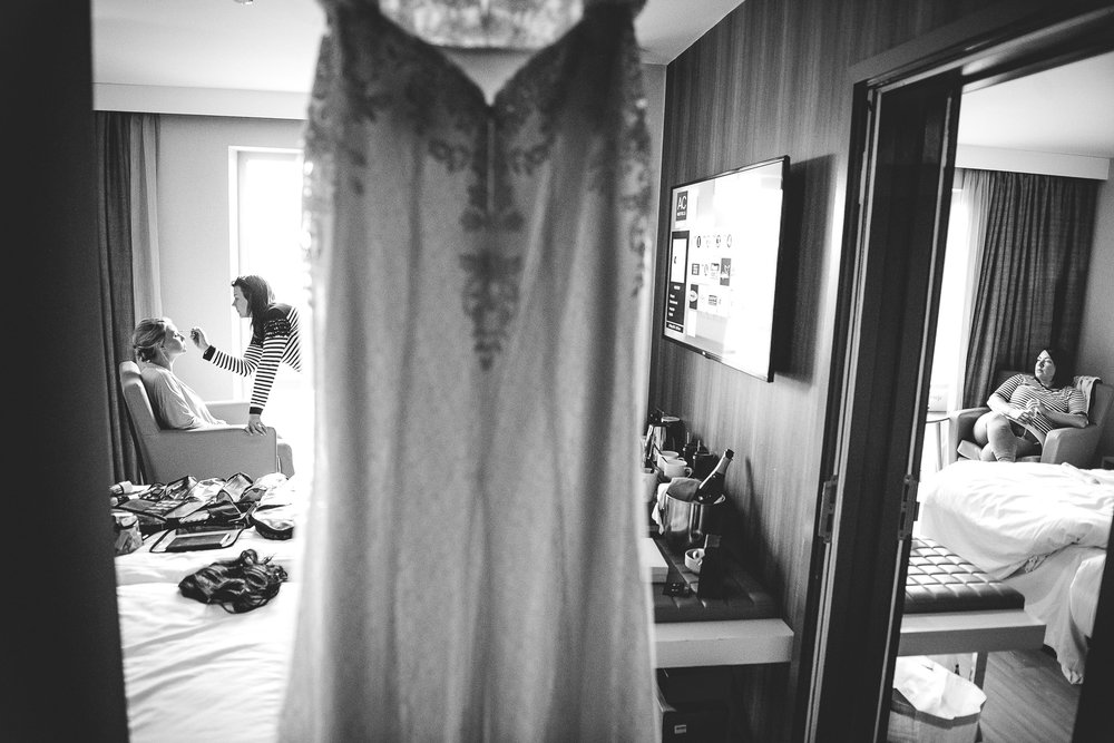 Bride getting ready while others wait