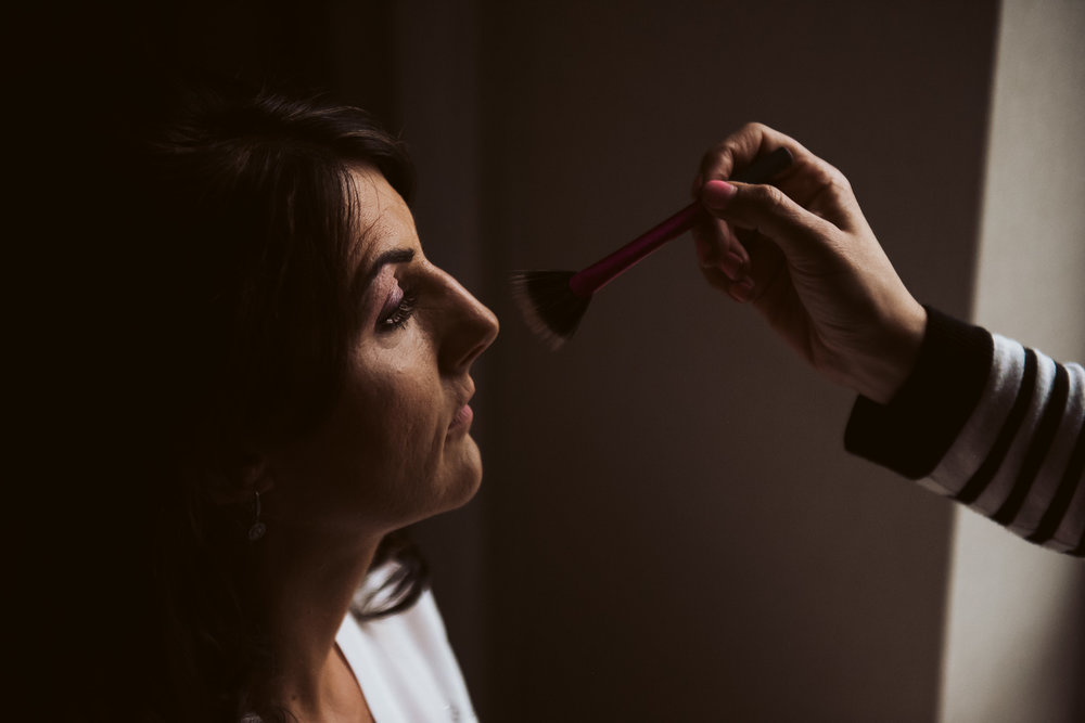 The bride touching up her make-up