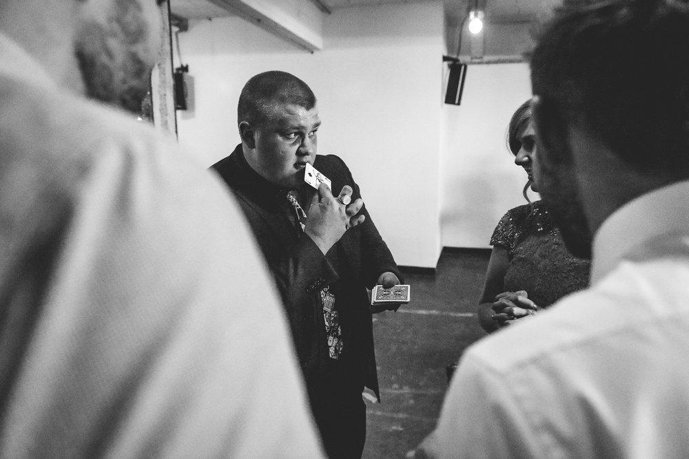 A magician performs card tricks at a Saldfor Quays wedding