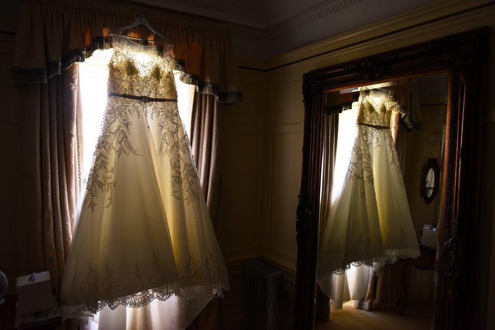 Reflection of wedding dress in mirror