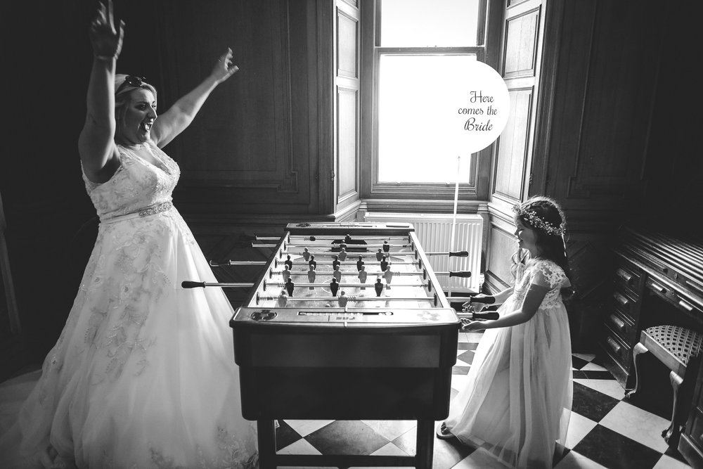 Bride playing table football