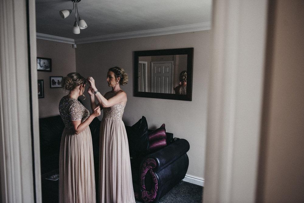 Bridesmaid's final adjustments
