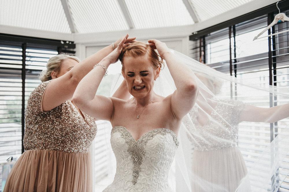 Bride attaching her veil