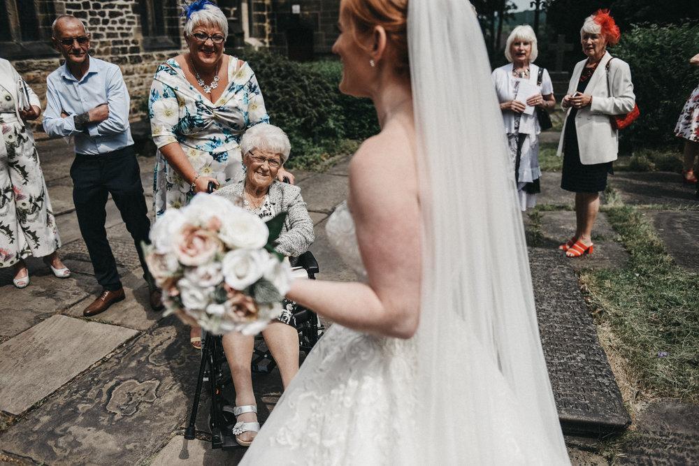 Old lady congratulating the bride