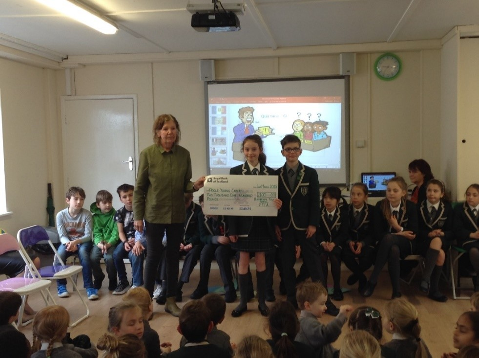 Poole young carers cheque.jpg