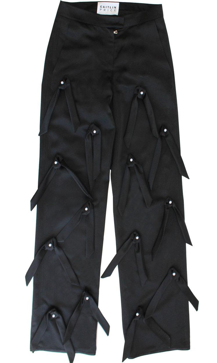 422fe6386184ba FLARE LEGGINGS. 490.00. black tie trousers.jpg