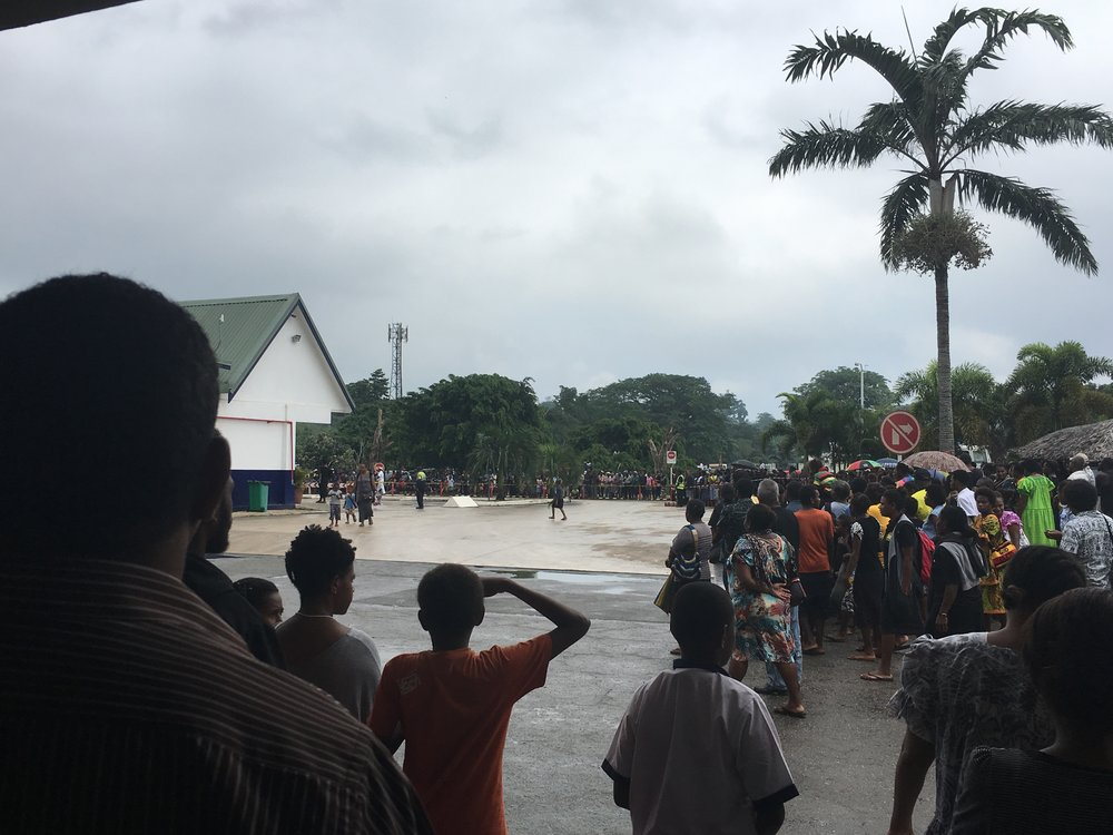 Waiting for the late president's coffin at the Port Vila Bauerfield Airport domestic terminal.