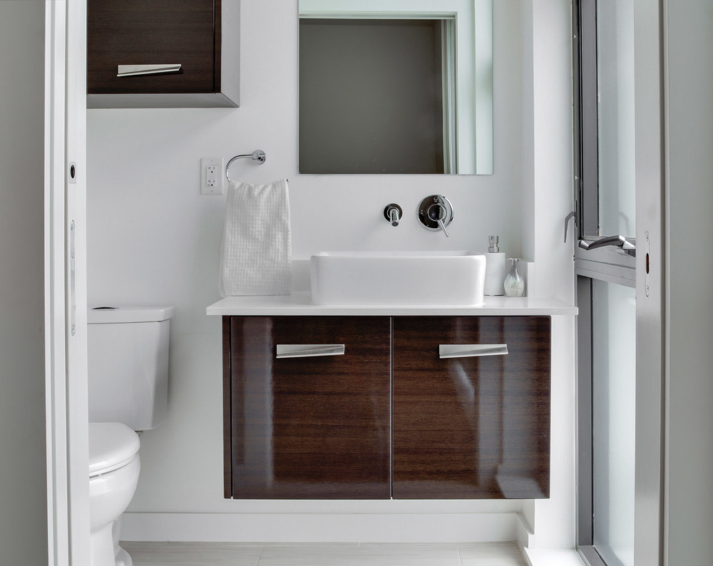 LOFT BATHROOM: Dark Wood Cabinetry