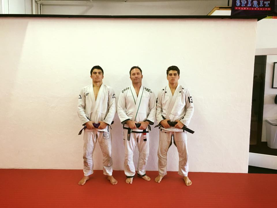Third degree black belt Lowell Anderson with sons Elias and Laird