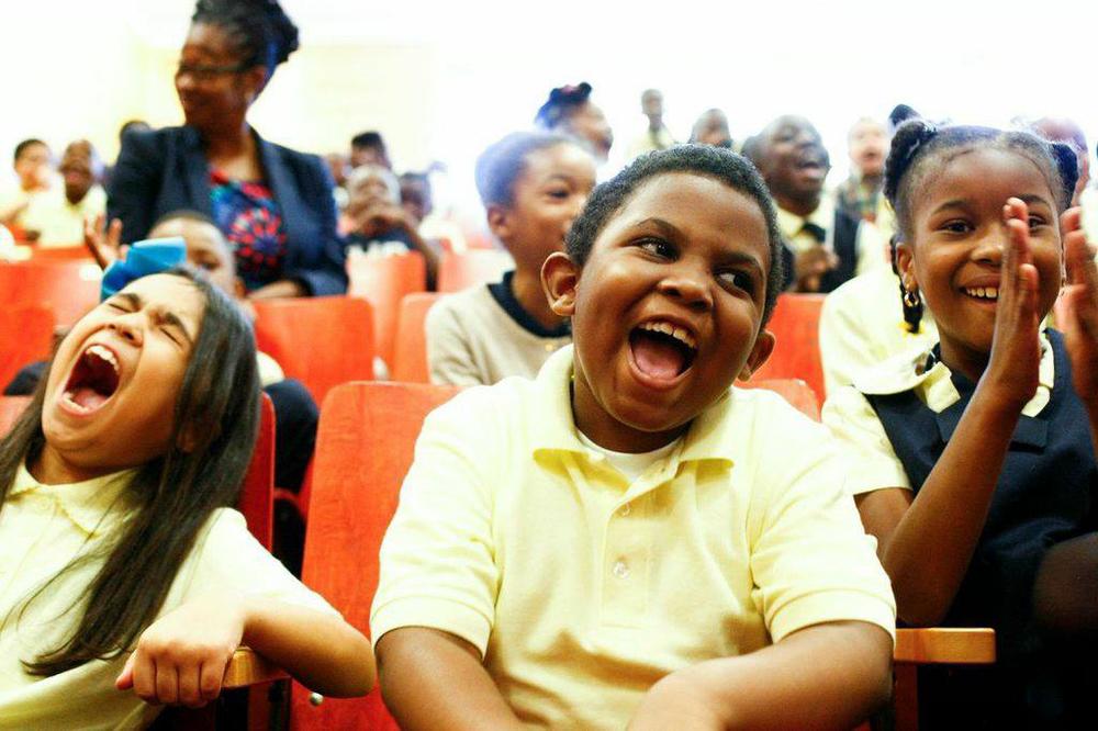 happy-kids-in-auditorium.jpg