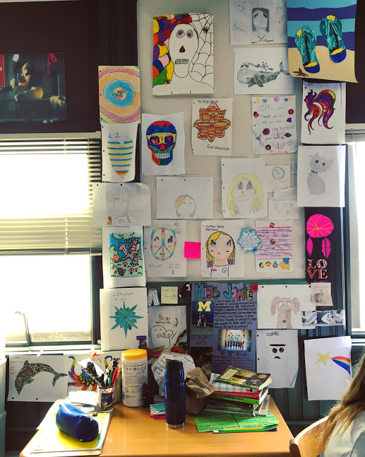 My desk is decorated with my students' artwork -
