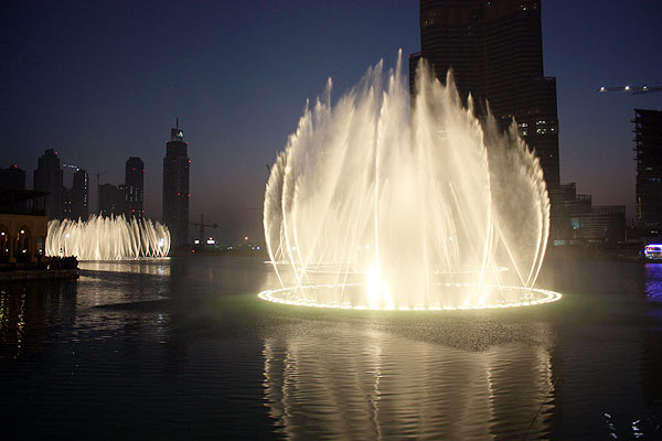 Dubai Fountain is the center piece of Downtown Burj Dubai located at the front of Burj Dubai. The Dubai fountain is one of the world's tallest fountains, surpassing the Fountains of Bellagio at Las Vegas. Courtesy of http://flashydubai.com/dubai-fountain-the-best-and-most-beautiful-dancing-fountain-in-world/
