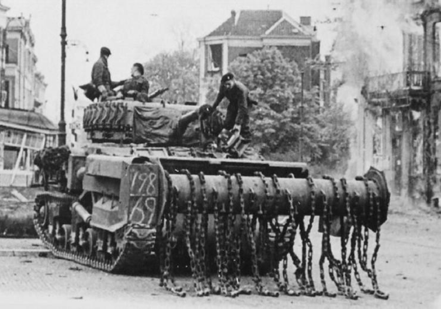 "One of MAJ GEN Sir Percy Hobart's ""funnies"" – a modified Sherman AVRE Flail tank. Specialised tanks like this saved thousands of allied soldiers by clearing lanes through mine-fields and barbed-wire entanglements. Image courtesy of  ThinkDefence.co.uk"