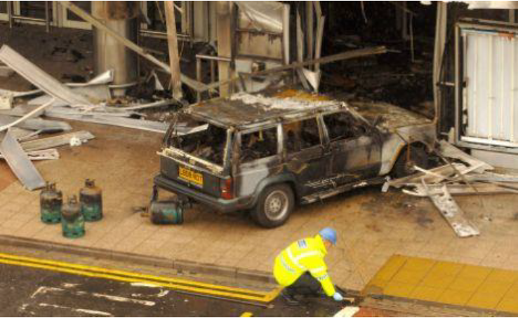 The 4WD vehicle used to smash into the Glasgow Airport Terminal in 2007 – note the large gas cylinders – planned to detonate from the heat of the blazing car. Image courtesy of  Daily Mail UK