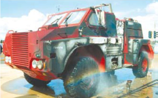 """A 'scorched' prototype Fire King after successfully withstanding the CSIRO's """"burnover standard"""". Despite the scorch damage this vehicle was driven off the test-bed after the test."""