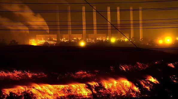 This night view of the  Hazelwood mine fire  details both the extent of the fire [foreground] and the close proximity of the power station [background].