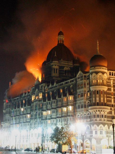 The iconic Mumbai Taj Mahal Palace hotel burns during the November 2008 terror attack. Image courtesy of  Arko Datta / Reuters