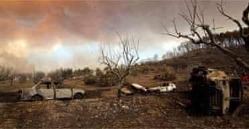 Burned cars in a field near Artemida. Image courtesy of  Milos Bicanski/Getty